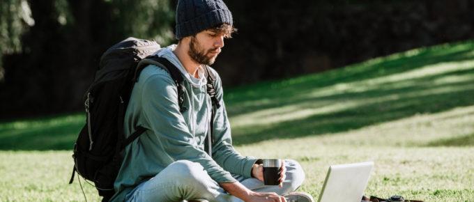 digital nomad backpack on in park